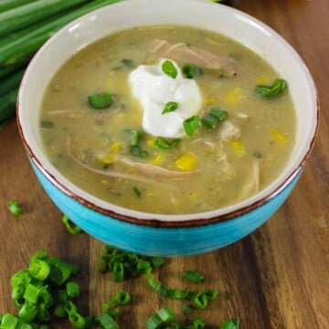 corn chowder in blue bowl with sour cream