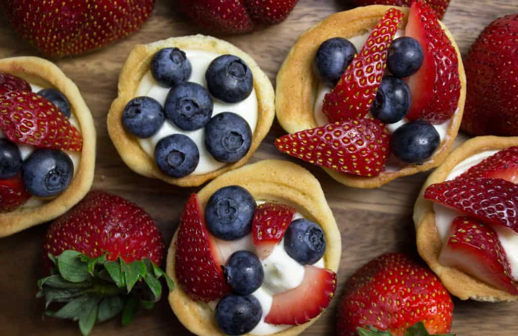 Sugar Cookie Cups with cheesecake filling and fruit topping