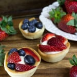 cookie cup filled with cheesecake and topped with berries