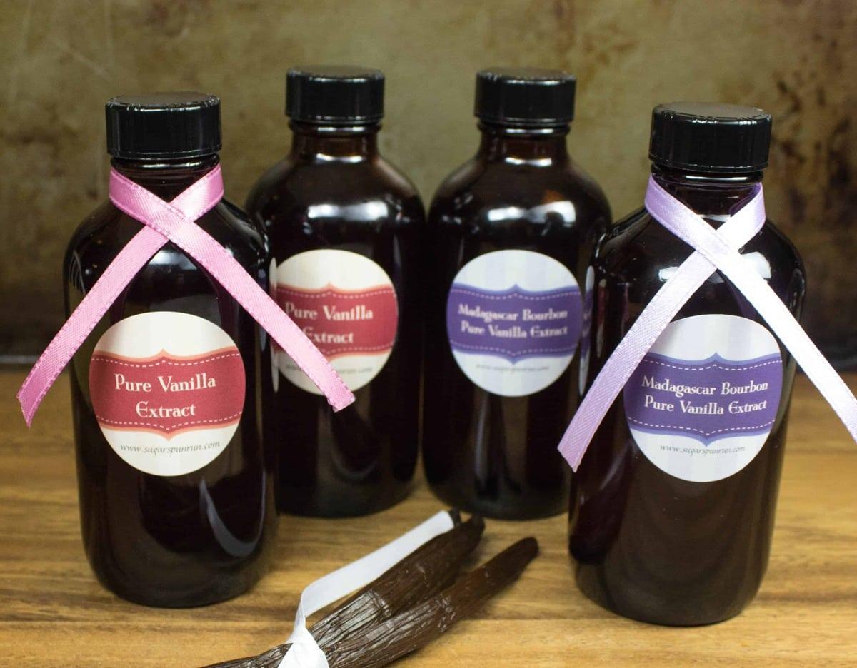 4 glass jars of homemade vanilla extract
