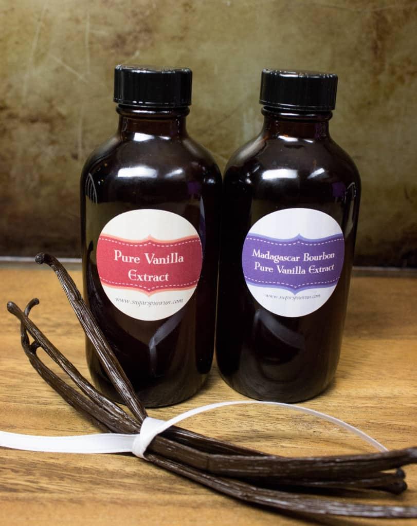 two glass jars homemade vanilla extract