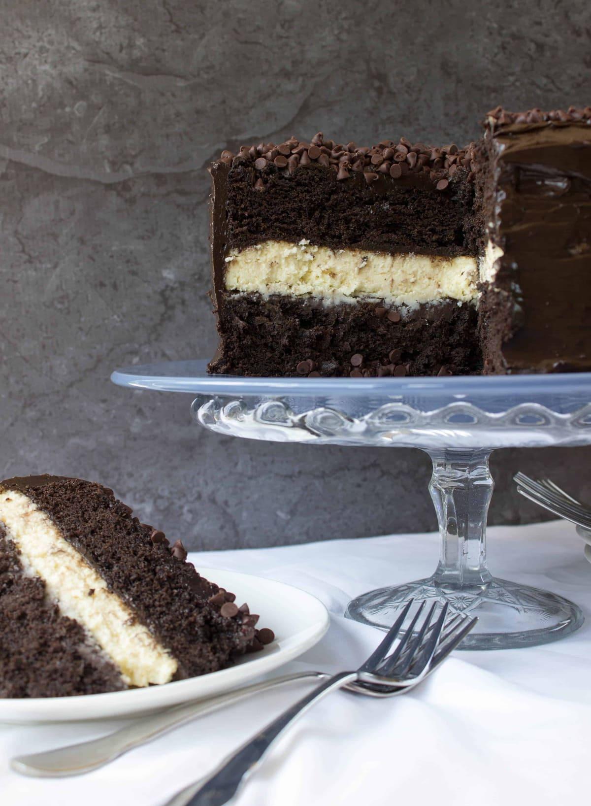Cheesecake Stuffed Dark Chocolate Cake - Sugar Spun Run