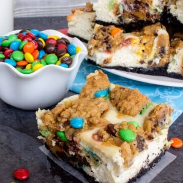cheesecake and cookie swirled bars with M&ms