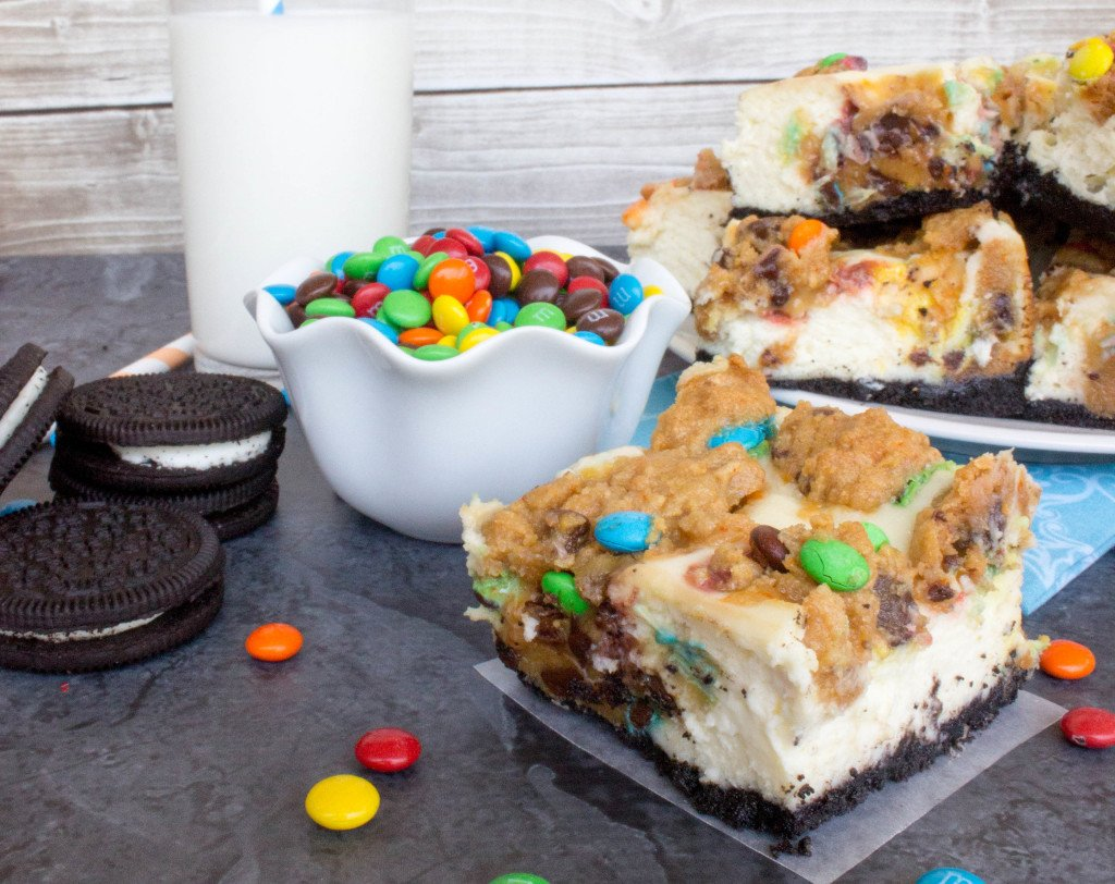 Monster Cookie Cheesecake Squares on an Oreo crust