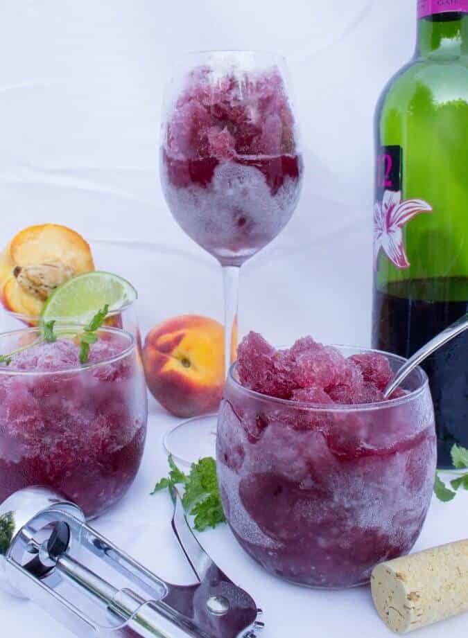 Peach Sangria Granita in wine glasses