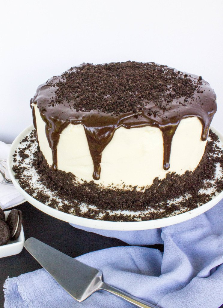 Cake with white buttercream and cookie crumbs and chocolate ganache