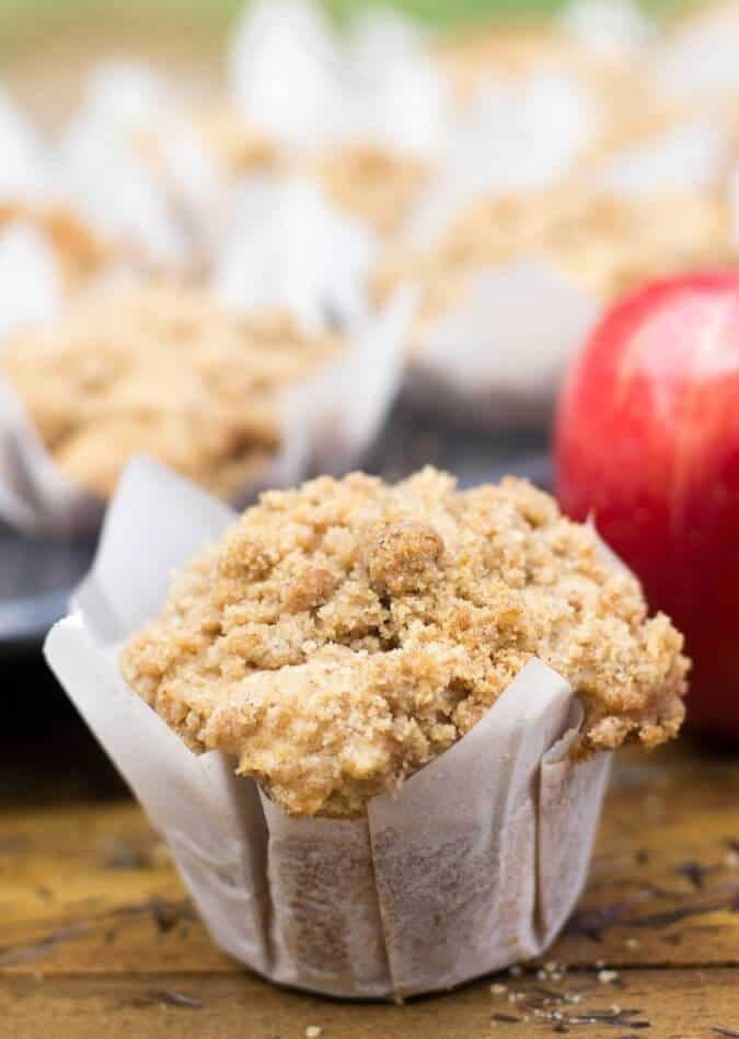 Muffin in white liner piled high with crumble topping