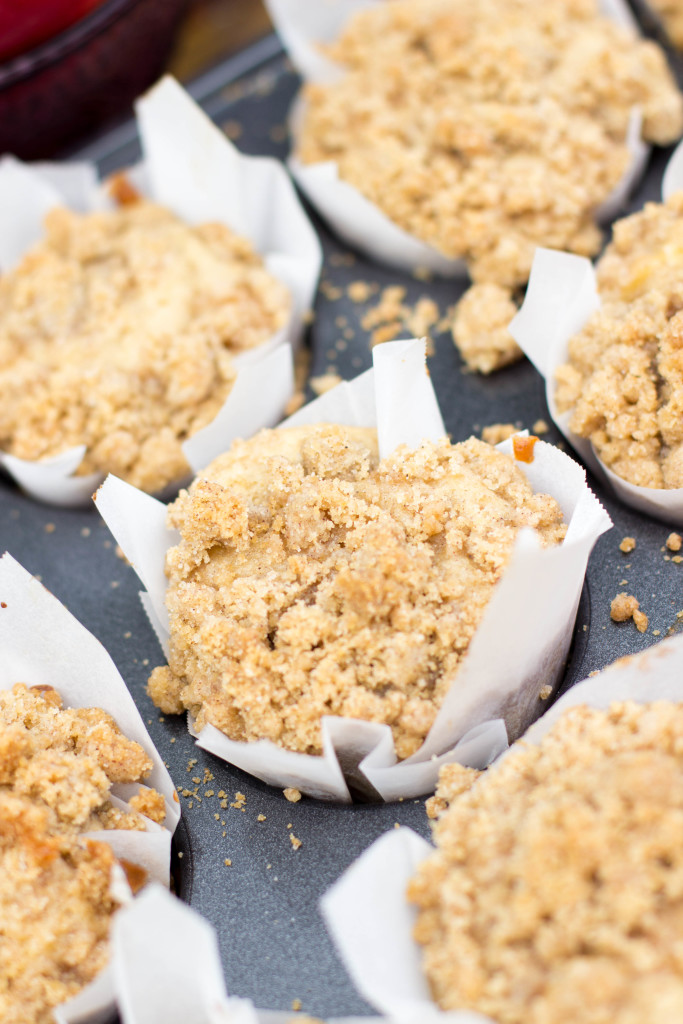 Apple Crumble Muffins-- soft and fluffy and loaded with apple pieces, pile high with a buttery crumble topping.