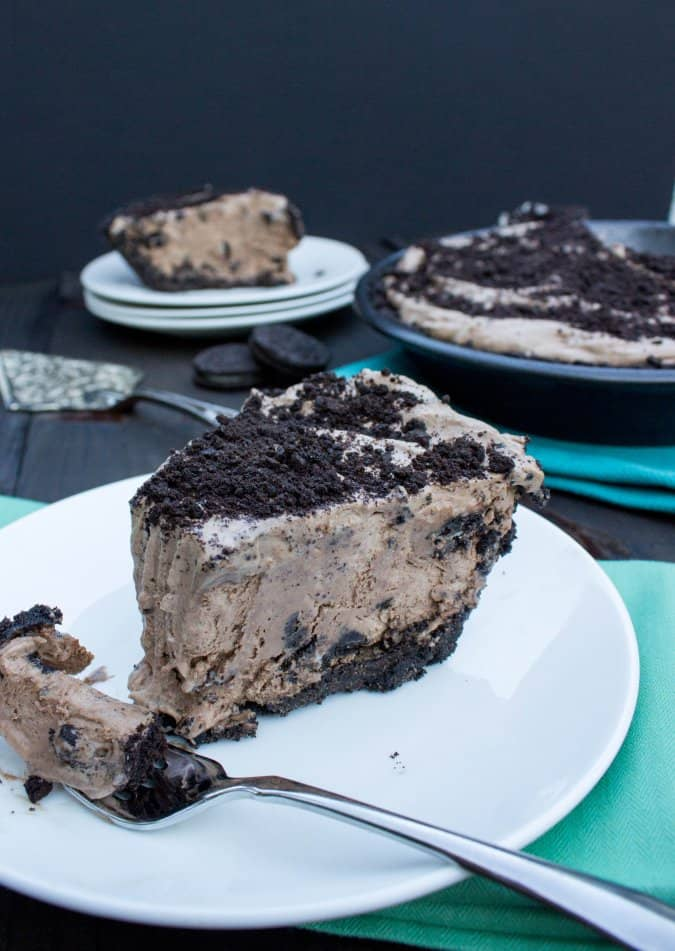 Cookies & Cream Mocha Ice Cream Pie on white plate with fork