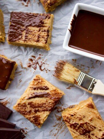 peanut butter blondies brushed with melted chocolate
