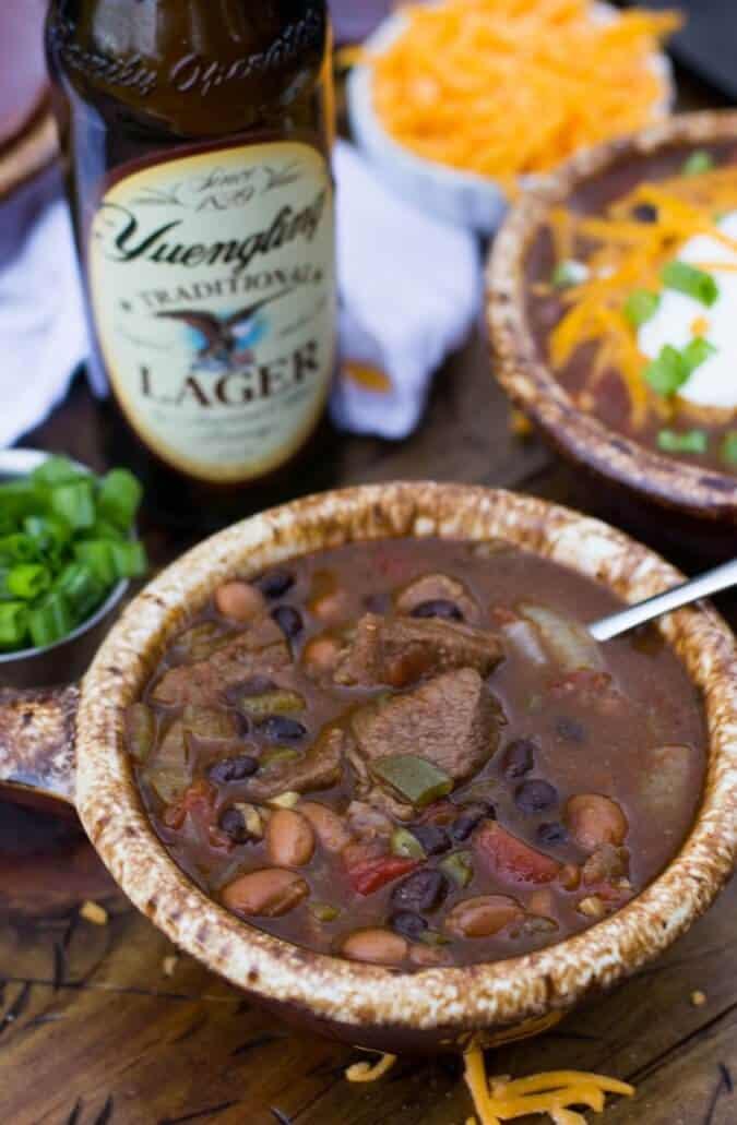 Beer Steak Chili in brown crock, Yuengling beer in background