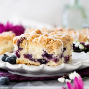 Blueberry coffee cake on white plate