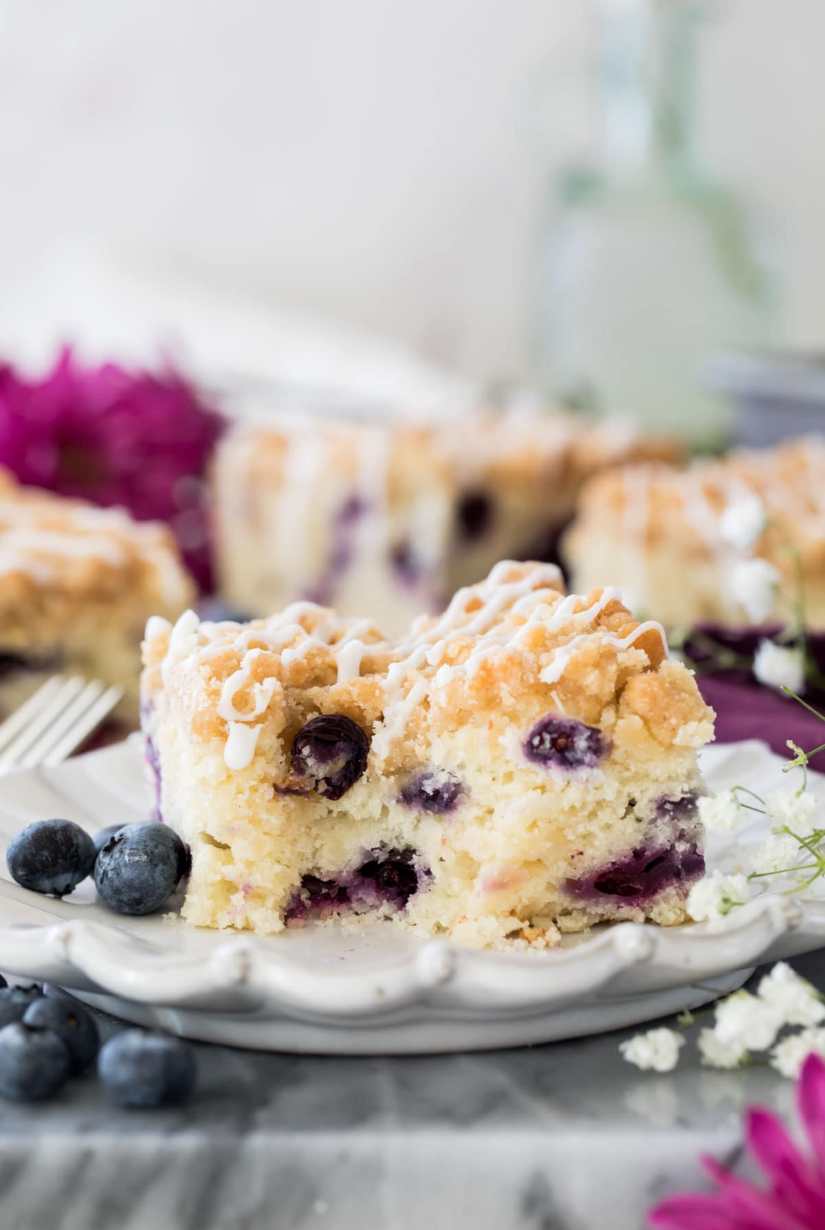blueberry cake with bite out of it