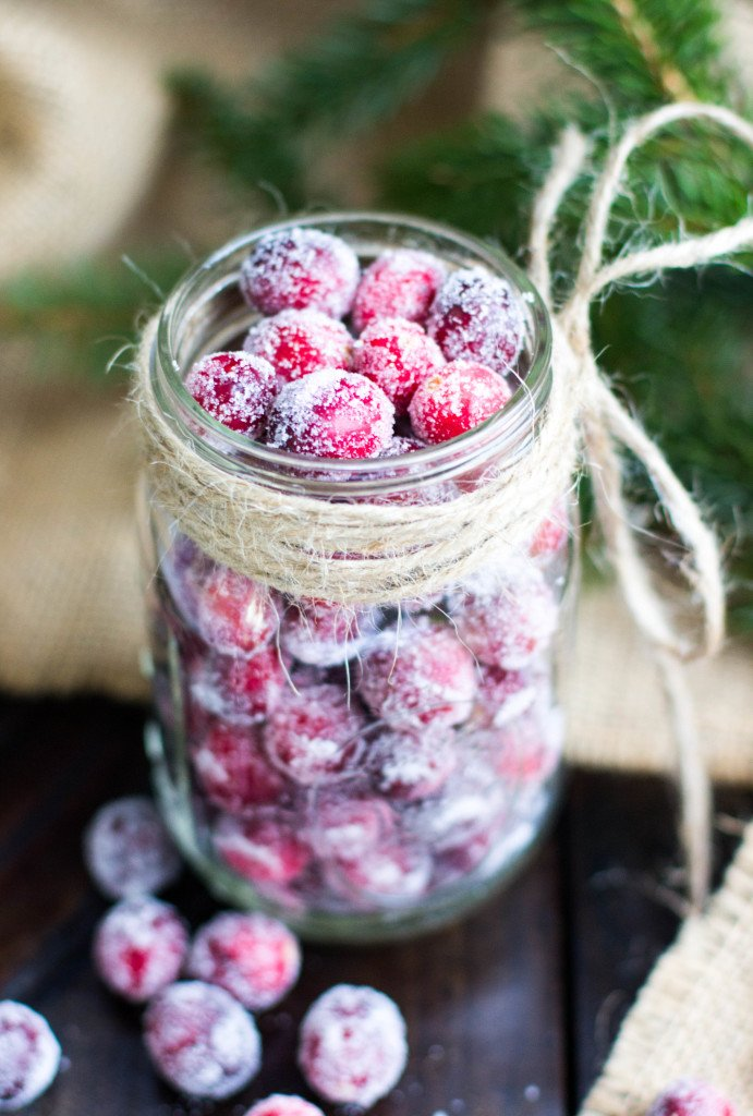 glass jar full of sugared cranberries