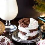 Stack of four peppermint bark cookies on a silver plate