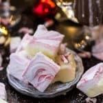 Peppermint marshmallow candy stacked on a silver plate
