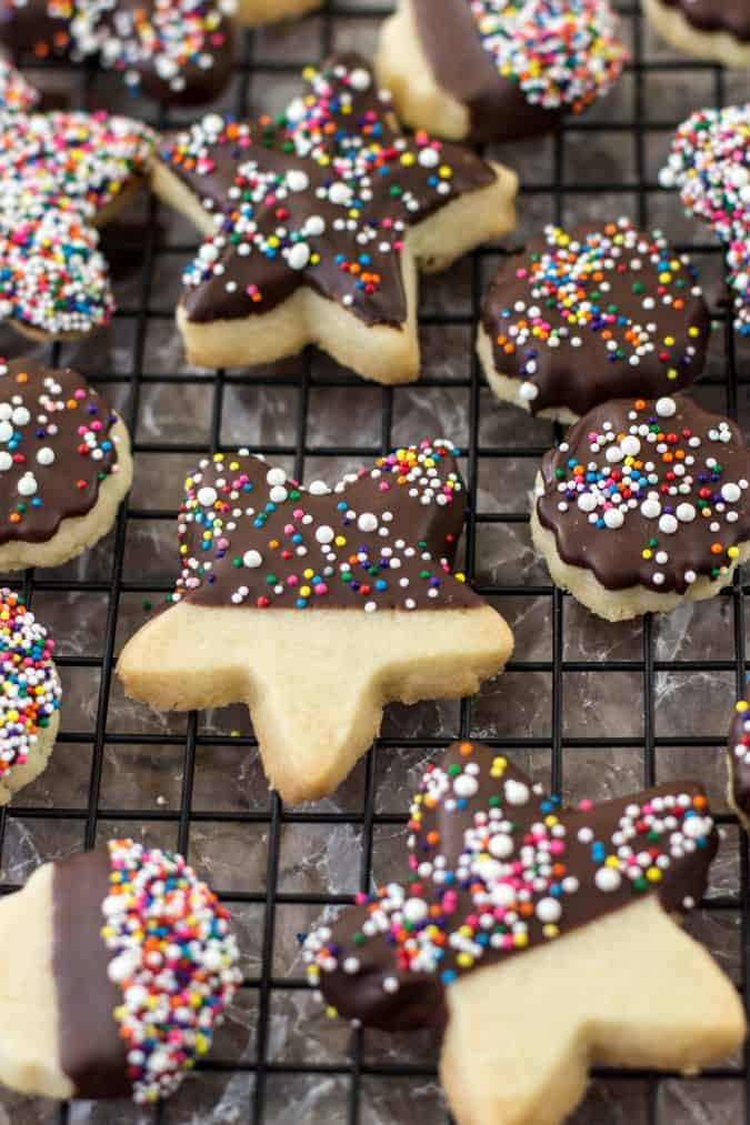star shaped cookies with chocolate on cooling rack