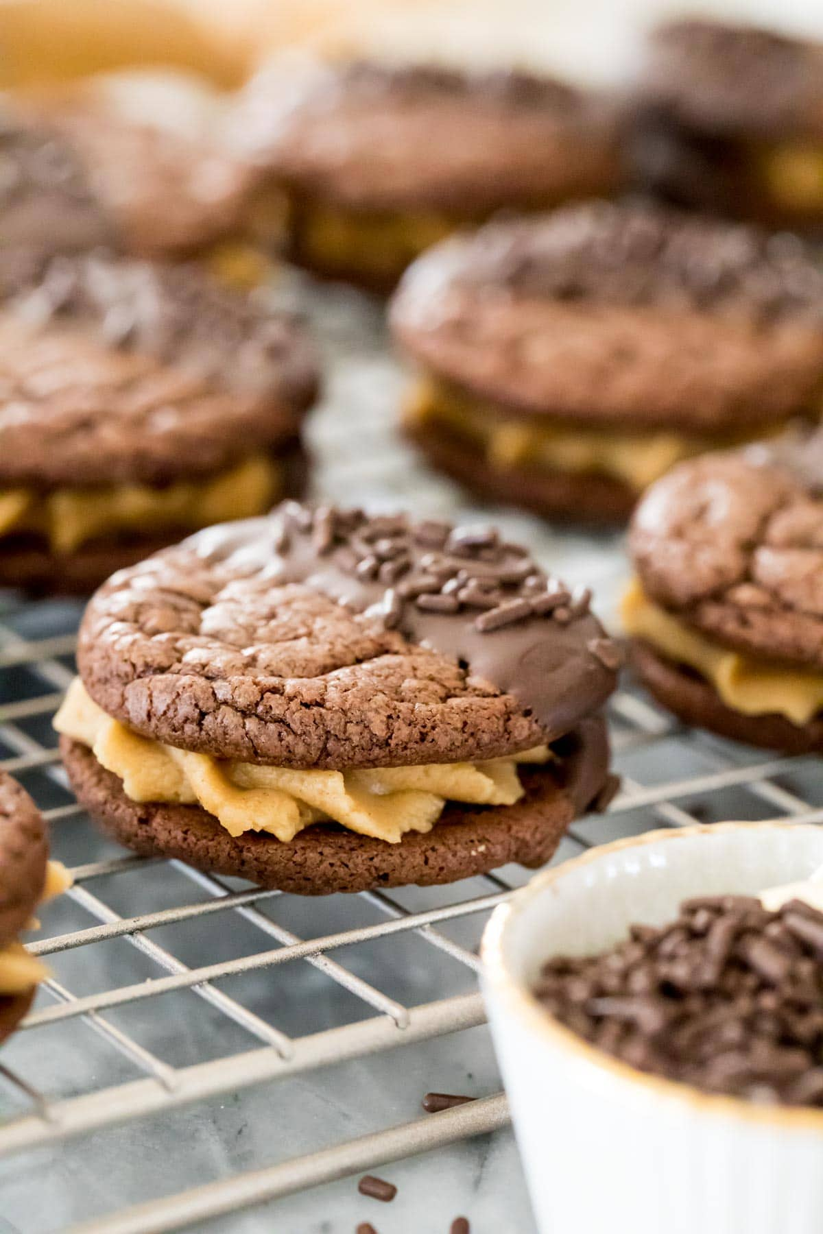 chocolte sandwich cookies on cooling rack