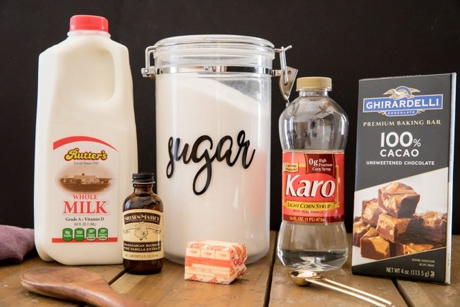 Ingredients for chocolate fudge (milk, sugar, corn syrup, chocolate, butter, vanilla)
