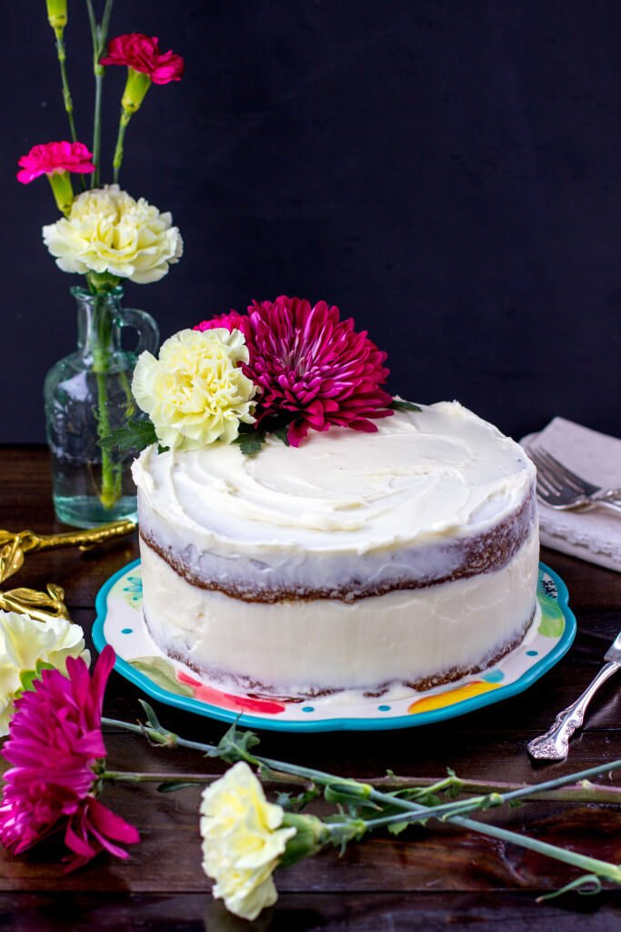 A decadent carrot cake with a surprise cheesecake layer in the middle -- SugarSpunRun.com