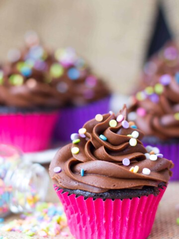 Chocolate cupcake with chocolate frosting, topped with sprinkles