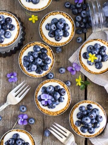 Overhead of blueberry lemon tarts