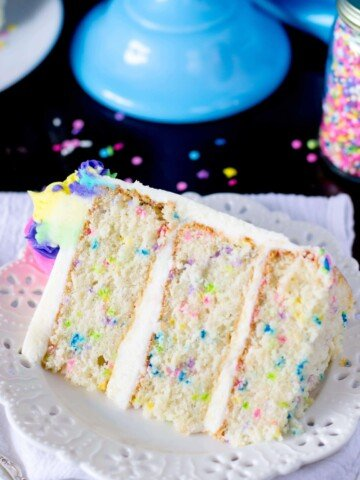 Slice of funfetti cake on a white plate