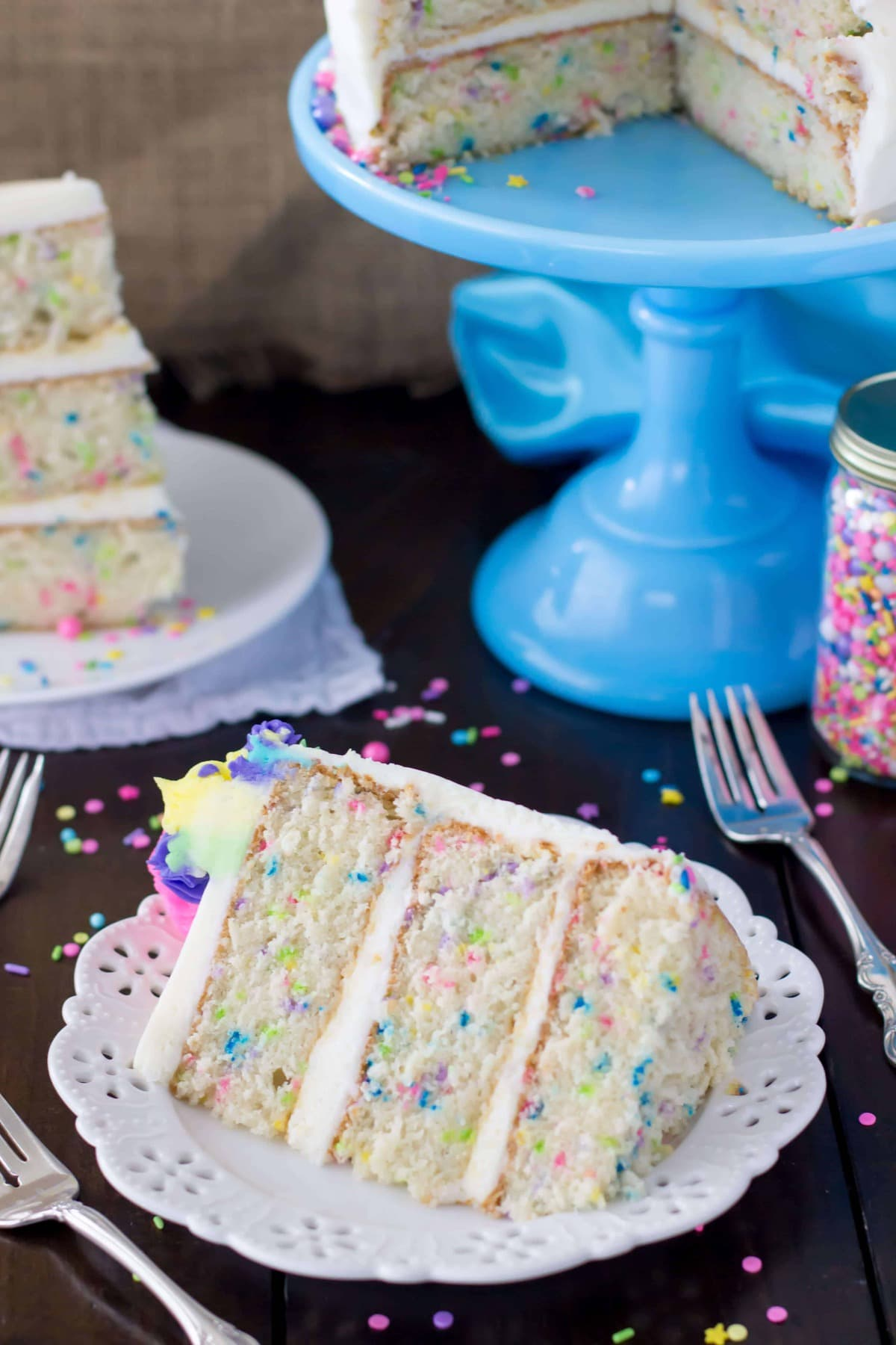 Fluffy Slice Of Funfetti Cake From Scratch Sugar Spun Run