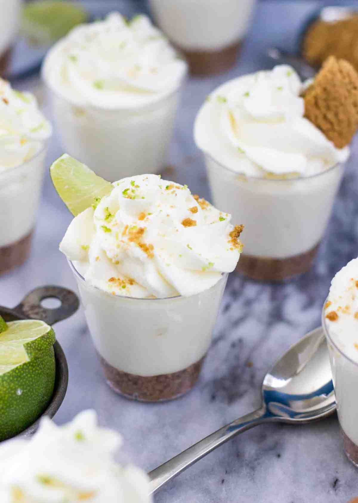 Key lime pie dessert shooters with gingersnap crust -- via SugarSpunRun