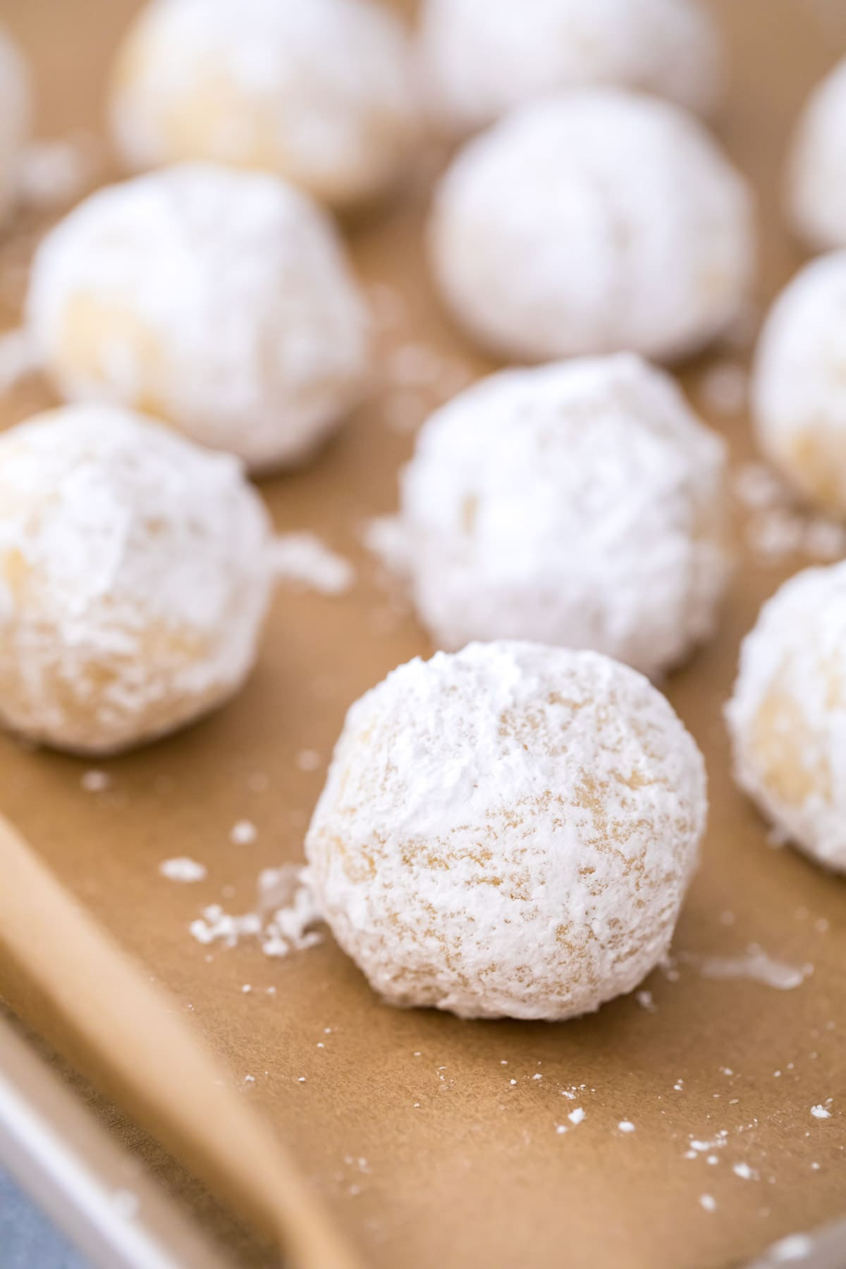 balls of cookie dough rolled in powdered sugar