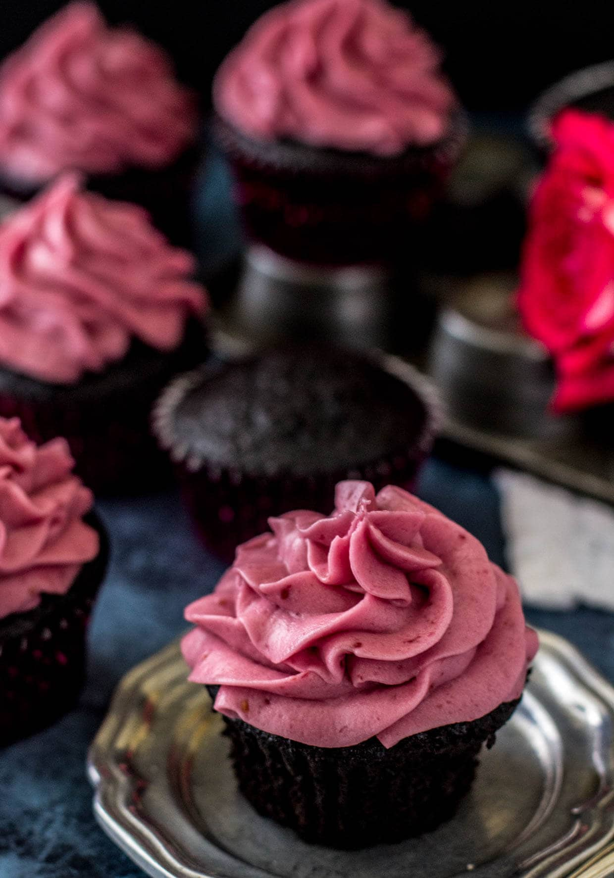 Dark Chocolate Cupcakes with Fresh Raspberry Frosting -- via Sugar Spun Run