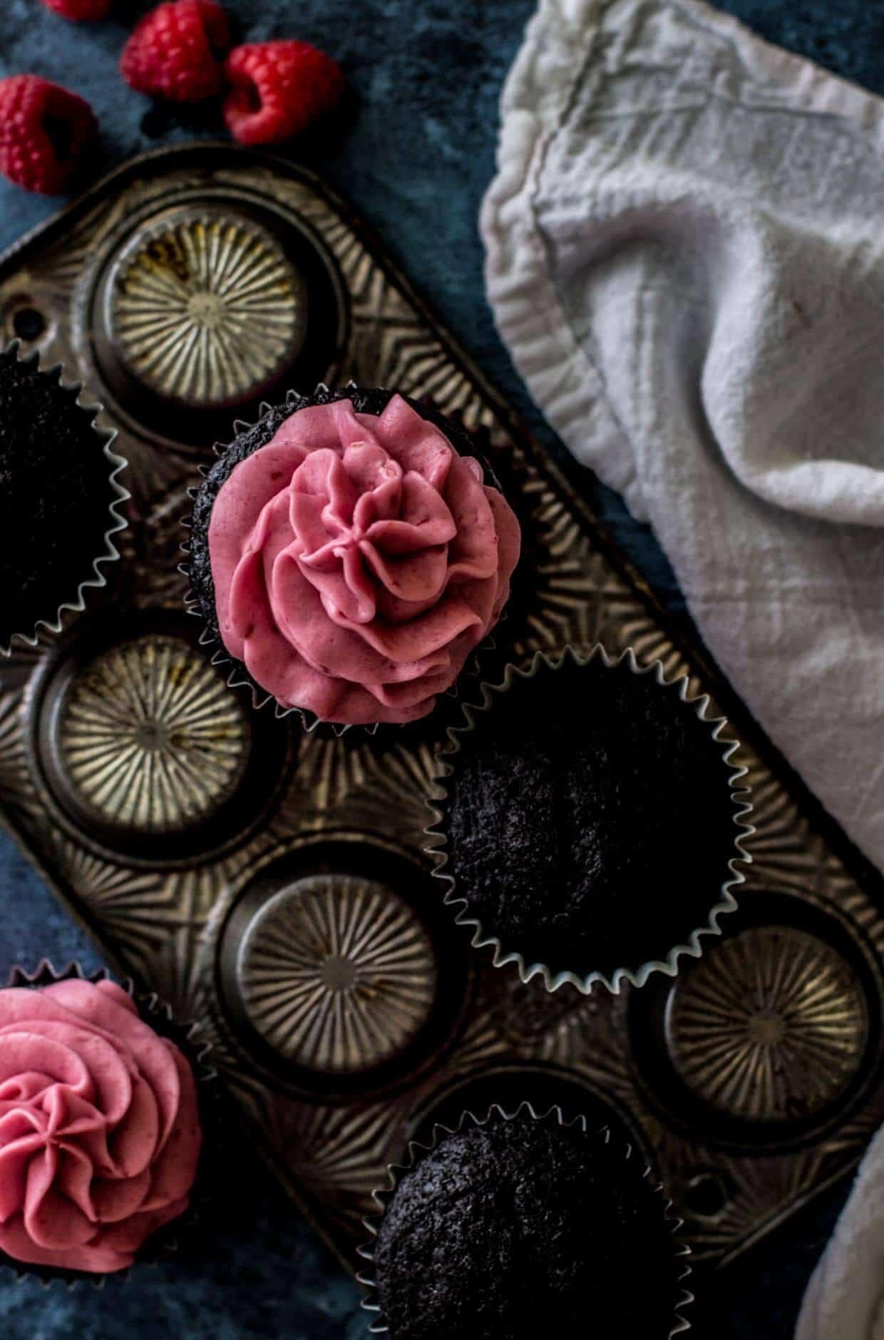 Dark Chocolate Cupcakes with Fresh Raspberry Frosting -- via Sugar Spun Run
