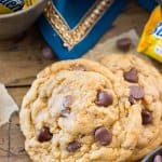 Butterfinger cookies with miniature butterfinger candy bars in the background