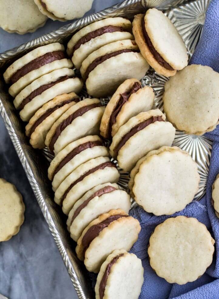 Vanilla Bean Sandwich Cookies with Chocolate Cream -- via Sugar Spun Run