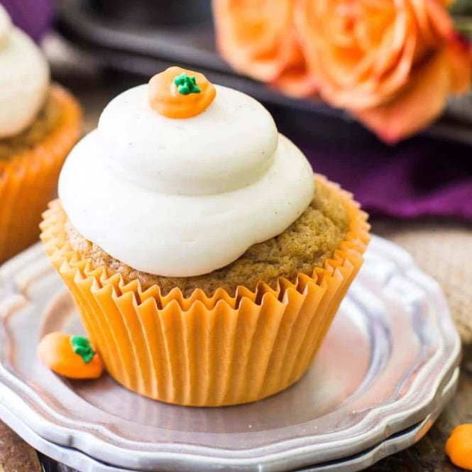 Pumpkin cupcake with frosting on silver plate