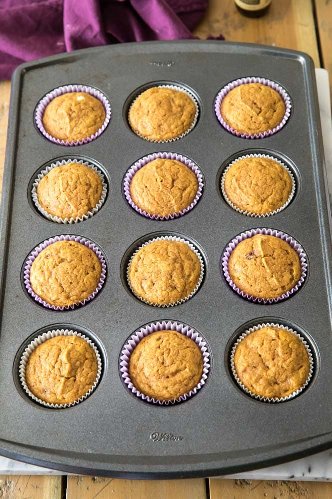 pumpkin cupcakes in muffin tin