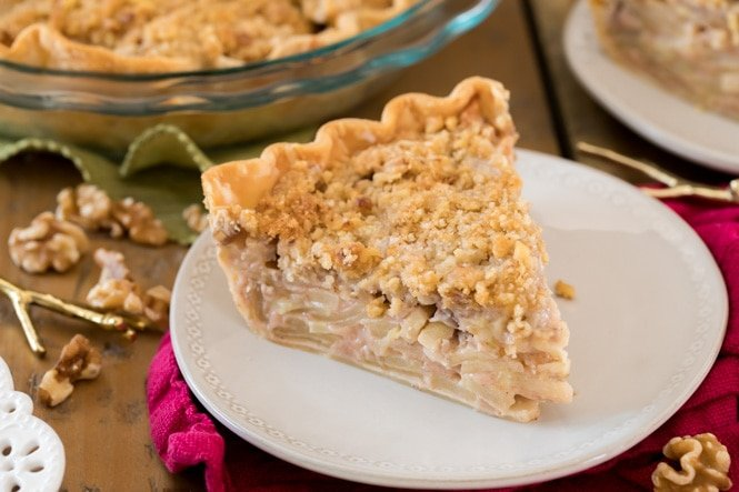 A slice of apple pie on white plate