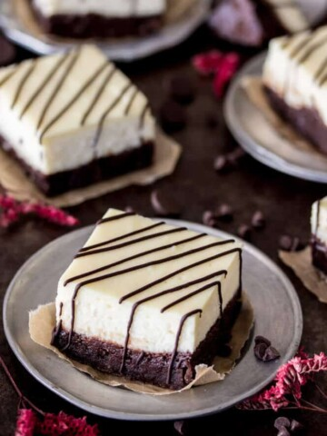 Brownie cheesecake square on a silver plate
