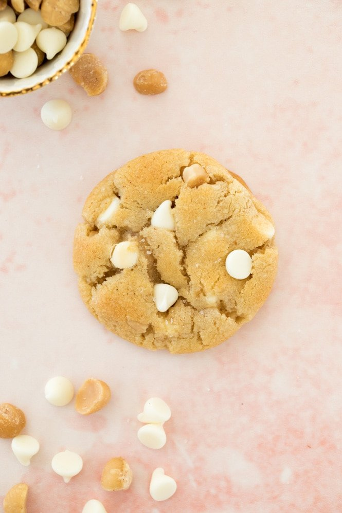 Overhead of white chocolate chip macadamia nut cookie -- showcasing the crackly tops