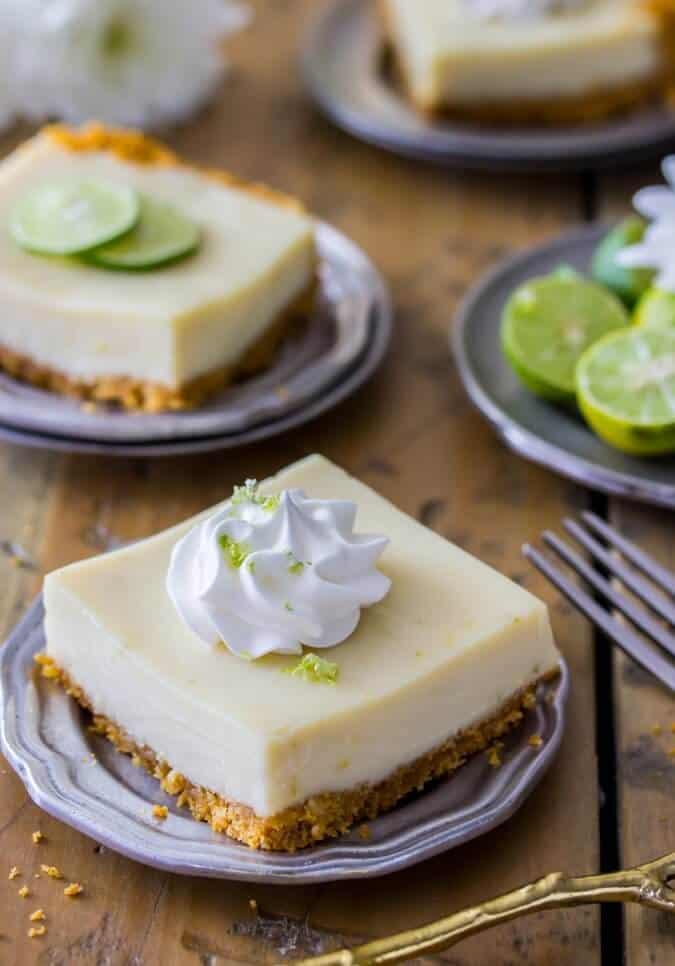 Tart, refreshing key lime pie bars on a homemade graham cracker crust || Sugar Spun Run