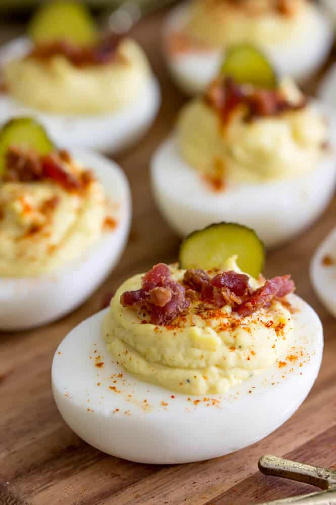 Best deviled egg topped off with paprika, bacon, and sweet pickle slices