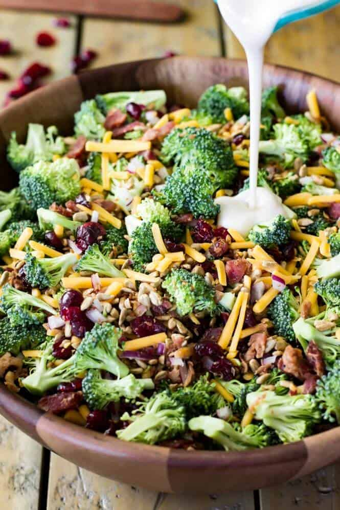 How to make broccoli salad, combining ingredients and tossing with homemade dressing