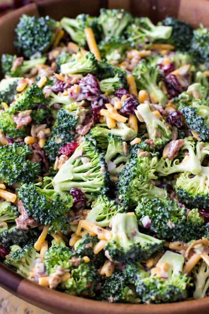 Broccoli salad with bacon in a wooden serving bowl