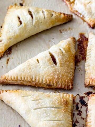 Apple turnovers on baking sheet