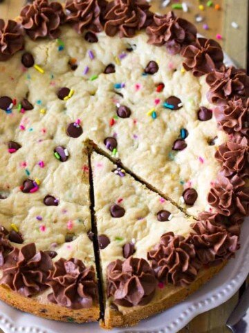 Chocolate chip cookie cake with slice cut