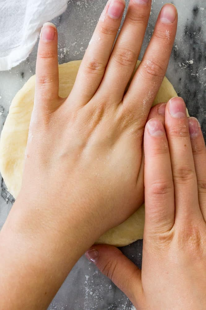 Use your hands to form your easy pie crust into a disk and flatten