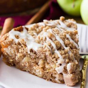 Slice of apple crumb cake on plate