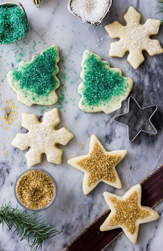 Sugar cookies shaped as stars, tress, and snowflakes