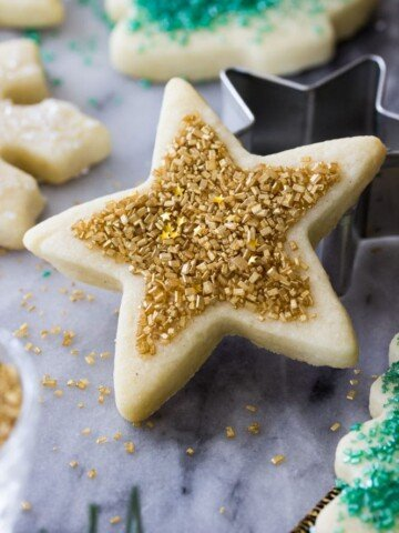 Star shaped sugar cookie with gold sprinkles