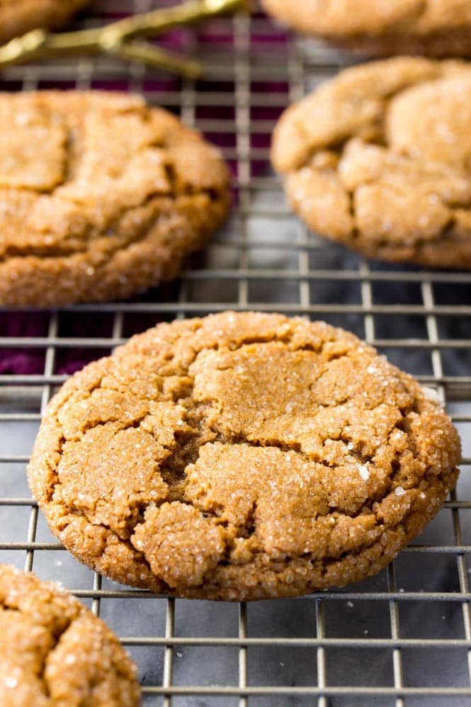 Thick chewy molasses cookie on cooling rack